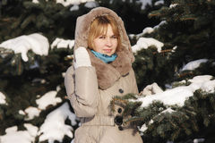 Blonde under big fir tree Royalty Free Stock Photos