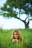 Blonde under tree Royalty Free Stock Images