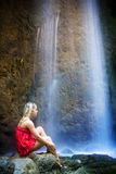 Blonde under waterfall Royalty Free Stock Images