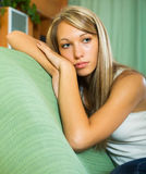 Blonde unhappy girl at home Stock Photo