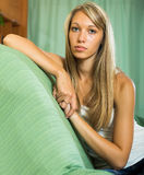 Blonde unhappy woman at home Royalty Free Stock Photo