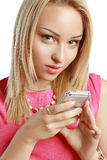 Blonde using mobile Stock Photos