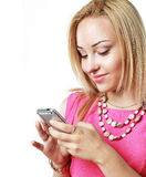 Blonde using mobile Royalty Free Stock Photos