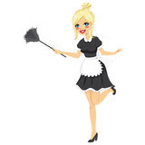 Blonde Vintage Maid Cleaning. Blonde girl with vintage maid dress cleaning using feather duster Royalty Free Stock Photography