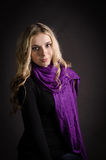 Blonde in a violet scarf Royalty Free Stock Photo