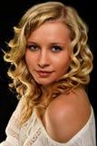Blonde vorbildliche Frau Stockfoto