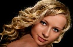 Blonde vorbildliche Frau Stockfotografie