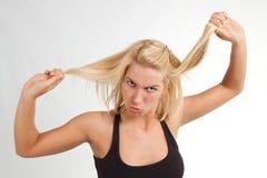 Blonde vrouw die grimas maakt Royalty-vrije Stock Foto