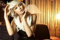 Blonde vrouw met blauwe ogen Royalty-vrije Stock Foto