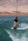 Blonde Wakboarding in the Desert Stock Image