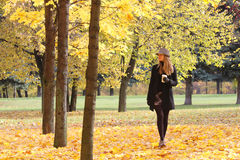 Blonde walking in park Stock Images