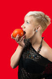 Blonde wants to eat tomato Royalty Free Stock Image
