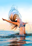 Blonde in the water waving hair Royalty Free Stock Images
