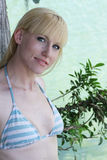 Blonde at waterside Stock Photography
