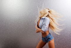 Blonde waving hair. A blonde woman waving her hair royalty free stock images