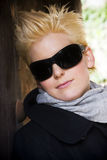 Blonde wearing big sunglasses Royalty Free Stock Photos