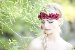 Blonde Wearing A Flower Cown Royalty Free Stock Images