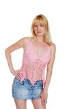 Blonde wearing a jean skirt with pink lace top Royalty Free Stock Photography