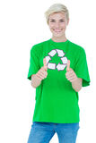 Blonde wearing a recycling tshirt gesturing thumbs up Royalty Free Stock Photo