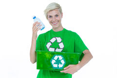 Blonde wearing a recycling tshirt holding recycle box Royalty Free Stock Image