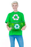 Blonde wearing a recycling tshirt holding recycle box Stock Image