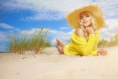 Blonde wearing sun hat at the beach Stock Photography