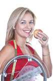Blonde with weigh and red apple Royalty Free Stock Photo