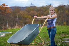 Blonde with a wheelbarrow Royalty Free Stock Images