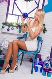 Blonde on white Christmas decorations in the terrace next to the Royalty Free Stock Images