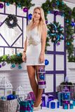 Blonde on white Christmas decorations in the terrace next to the Royalty Free Stock Image