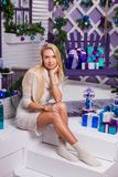Blonde on white Christmas decorations in the terrace next to the Royalty Free Stock Photo