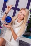 Blonde on white Christmas decorations in the terrace next to the Royalty Free Stock Photography