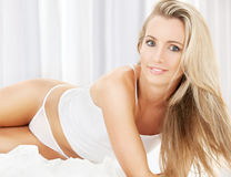 Blonde in white cotton underwear Royalty Free Stock Images