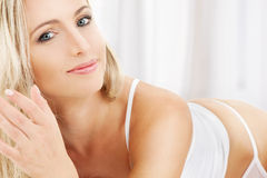 Blonde in white cotton underwear Stock Image