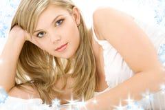 Blonde in white cotton underwear. Picture of blue-eyed blonde in white cotton underwear stock image