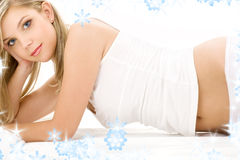 Blonde in white cotton underwear. Picture of blue-eyed blonde in white cotton underwear royalty free stock photo