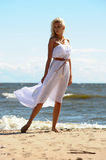 Blonde in a white dress Royalty Free Stock Photos