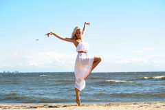 Blonde in a white dress Royalty Free Stock Images
