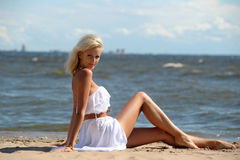Blonde in a white dress Stock Photo