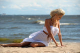 Blonde in a white dress Royalty Free Stock Photo