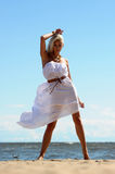 Blonde in a white dress Royalty Free Stock Image