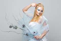 Blonde in a white dress with blue makeup. The Snow Queen. Blonde in a white dress with blue makeup. The Snow Queen Royalty Free Stock Photos