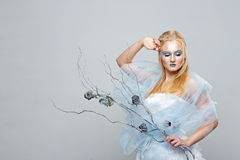 Blonde in a white dress with blue makeup. The Snow Queen. Blonde in a white dress with blue makeup. The Snow Queen Royalty Free Stock Photography