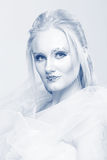 Blonde in a white dress with blue makeup. The Snow Queen. Blonde in a white dress with blue makeup. The Snow Queen Stock Photo