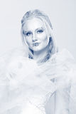 Blonde in a white dress with blue makeup. The Snow Queen. Blonde in a white dress with blue makeup. The Snow Queen Royalty Free Stock Images