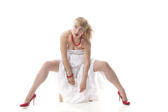 Blonde in white dress and red shoes Royalty Free Stock Photography