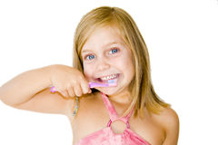 Blonde white girl brushing her teeth Royalty Free Stock Photos