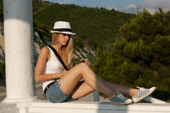 Blonde whith white hat and suspenders Stock Photography
