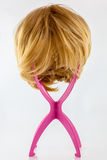 Blonde wig on stand Stock Photo