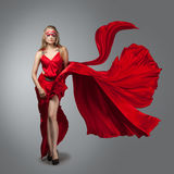 Blonde in windy  dress. Royalty Free Stock Image